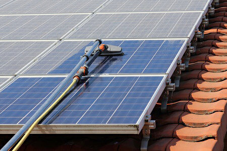 Photo of professional cleaning of solar panel on the roof